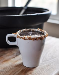 Slow Cooker Coconut Hot Chocolate.  Grab a few ingredients, and a crockpot? I am DOWN! This looks AMAZING.  Chocolate and coconut is one of my favorite flavor combinations!