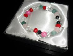 Bracelet made of semiprecious stones swarovski crystal, rock crystal, agate and rose quartz