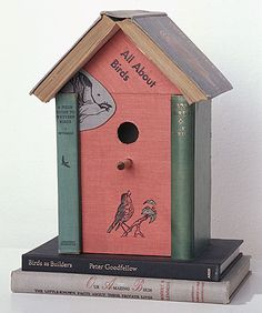 Jim Rosenau recycles books into shelves and bookcases themselves. This little piece is less functional but no less delightful. His careful placement of title and graphics delights, and of course the 'supporting cast' has appropriate nomenclature as well...