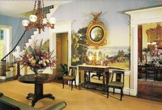 The wallpaper in the entrance hall of Monmouth Plantation in Natchez, Mississippi is Zuber. Photo: Mary E. Nichols. Architectural Digest (November 1998).