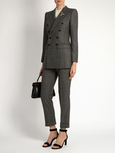 Dolce & Gabbana Prince of Wales-checked wool blazer  Dolce & Gabbana's tonal-grey Prince of Wales-checked wool blazer is embroidered with the label's signature bee motif – encrusted with crystals for a subtle shimmer. This sharp double-breasted style has a single back vent and spot-print lining for the smoothest line. Wear it with the coordinating trousers for a stylish alternative to an expected evening dress.