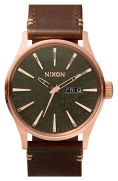 "Free shipping and returns on Nixon 'The Sentry' Leather Strap Watch, 42mm at Nordstrom.com. <p><B STYLE=""COLOR:#990000"">Pre-order this style today! Add to Shopping Bag to view approximate ship date. You'll be charged only when your item ships.</b></p><br>Elongated indexes give a sleek, modern look to a dial with a retro day-and-date window in a round watch paired with a leather strap."
