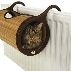Hooks on to the radiator - my cat would love me forever for this one!