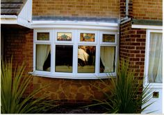 A 4 sided bow window with decorative top lights www.imagewindows.com