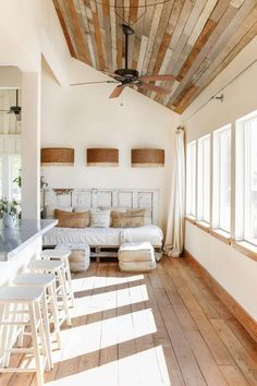 Another white and wood room but this one has old barn wood on the ceiling! I love the bright big windows too