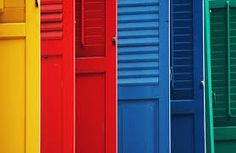 a colorful rainbow of doors. All The Colors, True Colors, Vibrant Colors, World Of Color, Color Of Life, Taste The Rainbow, Colorful Pictures, Shutters, Rainbow Colors