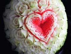 Heart and flowers melon carving.  This is incredible!