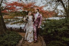 His floral pink suit, her Rue de Seine dress, their love for dark colors + tones – it was a moody boho wedding meant to be! Groom Wear, Groom And Groomsmen, Groom Attire, Glamorous Wedding, Boho Wedding, Wedding Groom, Wedding Attire, Wedding Meaning, Modern Groom