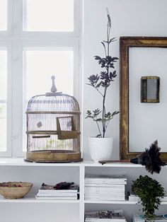 a bird cage vignette.: like this styling, via digs digs.