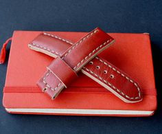 22x22mm red leather watch strap panerai style 100% handmade leather strap watch is made of premium quality Italian leather. Stitched entirely by hand very high quality waxed thread.  -Size on watch 22 mm -Size on buckle 22 mm -Long part 125 mm -Short part 85 mm. -Thickness about 4 mm -Color red  Made in one piece. Will be perfect and reliable decoration for your wrist watch. I hope you enjoy. !!!Make sure that the distance between the watch case and springbars is targeted for thick strap…