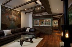 What a weird space! The shingles, the rafters, the coffee table, the fireplace...Bizarre, but I love it.