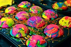 Rainbow Spatter Cupcakes!    Using white cake mix, make batter as directed. Use several plastic (or glass) cups, pouring white batter in them, divide between all cups. Add food coloring to each cup for the colors desired. Mix each cup and then put a little of each color in each muffin cup in small blobs. Then drizzle other colors over the blobs. Bake as directed.