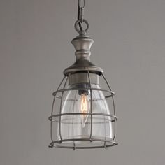 Metal Cage and Open Glass Pendant Stylized like an antique lantern yet has a modern industrial tone. The contoured metal cage of this pendant is perfect for a kitchen or utility room.