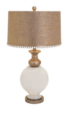 IMAX Lily Glass Lamp - Designer Becky Fletcher is known for her delightfully embellished lampshades. Here, burlap goes glam in gold with a belt of white and gold trim atop a white glass base accented in burnished gold. – Modish Store