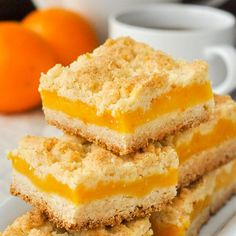 Orange Custard Squares - an old fashioned favourite cookie bar recipe made with a rich orange custard filling between 2 layers of shortbread crumble.