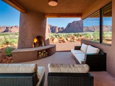 """The design of the fireplace by Archaeo Architects is based on the traditional kiva fireplaces popular in the southwest. """"The kiva fireplace is normally set in the corner of a room,"""" says Archaeo's Jon Dick. """"In this instance, we brought the fireplace to the exterior, so what would have been walls is now a view to the red rock landscape."""""""