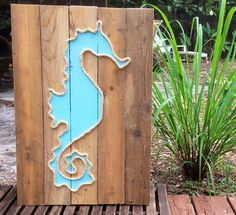 A personal favorite from my Etsy shop https://www.etsy.com/listing/211924271/handmade-seahorse-with-rope-beach-pallet