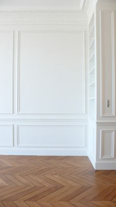 Warm wood floors and all white walls with Wainscoting . Warm wood floors and all white walls with Wainscoting and crown molding. Warm wood floors and all white walls with Wainscoting and crown molding. Picture Frame Molding, White Picture Frames, Picture Frame Wainscoting, Wainscoting Ideas, Dining Room Wainscoting, Bedroom Flooring, Planchers En Chevrons, Parquet Chevrons, Herringbone Wood Floor