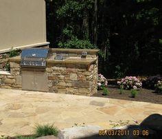 stone, outdoor kitchen, concrete, retaining walls,
