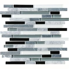 Accent tile for the backsplash behind the sinks, in the shower niches, and through the middle of the shower wall.