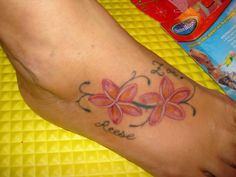 plumeria tattoos | The Plumeria flowers symbolize birth & life in the Hawaiian culture.