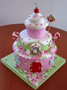Such a whimsical cake. Strawberry shortcake B-day cake