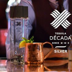 #DÉCADA Mexican Mule: • 1.5 oz. DÉCADA Silver Tequila • 1 oz. Fresh Lime • 1 oz. Simple Syrup • 2 oz. Ginger Beer • 10-12 mint leaves  In a glass, lightly muddle half the lime with the mint -- Add ice, Tequila, simple syrup, and squeeze the juice from the other half of the lime, Shake, Pour into a chilled copper mug, Top with ginger beer. Garnish with mint sprig and lime wedge.  #DÉCADA #Tequila #RaiseTheBar #TransformYourTaste #NoMoreBurn #TheSmoothest #LiquidLuxury