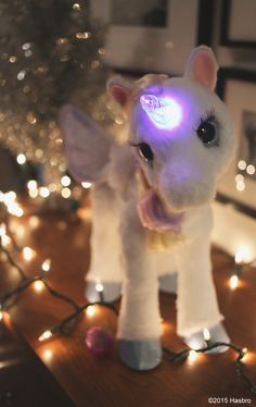 StarLily My Magical Unicorn makes the holidays brighter with her glowing horn. Sponsored by FurReal Friends