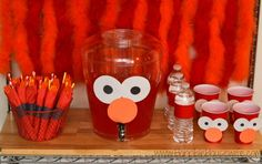 Elmo birthday party ideas- dress up your drink station with construction paper eyes and noses