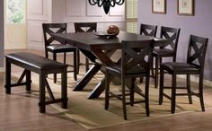The X-Factor Pub Dining collection is crafted of Asian hardwoods and mango veneers in a merlot finish. The collection features an X design base and stool. The table expands from 42x54 rectangle to 54x54 square with one 12