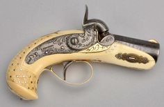 "Beautiful gun marked with Slotter markings ""J. Derringer, Philadelphia"", signed on lock and breech. Barrel has classic original Slotter finish. Brown with striping pattern. 90% of finish remains, however it is fading to dark brown. Gun has an ivory stock and solid gold mounts. Also, a gold front sight and double gold bands at the breech, mounts are beautifully engraved, in the exact same style as the steel parts."
