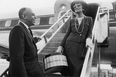 "Gabrielle ""Coco"" Chanel and American department store executive Stanley Marcus at a Dallas airport in 1957. Image via The Fashion Spot"