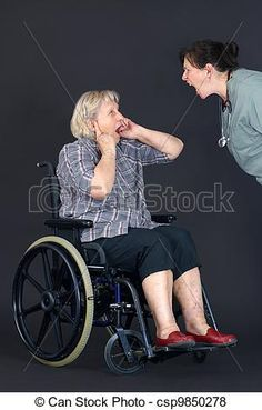 Stock Photo - Elder abuse senior woman being shouted at by nurse - stock image, images, royalty free photo, stock photos, stock photograph, stock photographs, picture, pictures, graphic, graphics