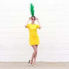 Turn a yellow dress into a last minute pineapple costume for Halloween. All you need is poster board!