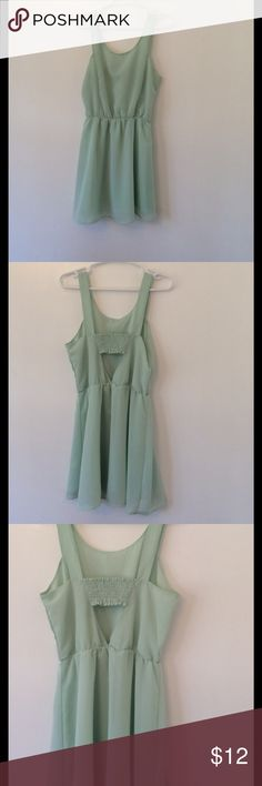 "H&M Mint Green partial opened back dress Size 12 Simply put...scoop neck, gathered waist, but ck out the back! Partial opened back (see pic 2). Lined from the waist down. 100% Polyester. Length: 34 1/4"", Bust: 17"", Waist: 12 1/2"".       Smoke Free Home H&M Dresses"