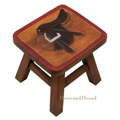 "Hunt Saddle Foot Stool. Solid wood stool is hand-carved and painted. Top of stool has a carved and painted image of a English Hunt Saddle. A useful accent for the equestrian home and will be greatly appreciated as a gift. 10"" tall, top is approx. 11""x10"