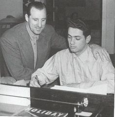 1953: As Hank Greenberg watches, Rocky Colavito signs contract with the Cleveland Indians.