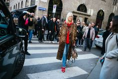 Street Style Photos From Fall 2017 Milan Fashion Week: As such, it follows that Milanese street style would be next-level eccentric and totally inspiring and fantastic. Daniel Kim of Walking Canucks is our man on the ground capturing all the very best of the best of Milan Fashion Week street style.---- Cheetah trench jacket and red hoodie.     Coveteur.com