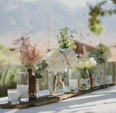 Vases   http://plectrumbanjo.info/backyard-wedding-robin-and-dave/row-of-flower-vases-and-candle-centerpieces/