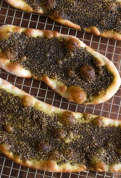 Middle Eastern flatbread topped with a blend of herbs and spices ...