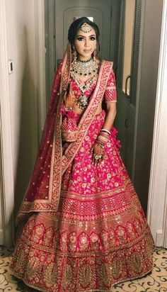 30 Exciting Indian Wedding Dresses That You'll Love is part of Pink bridal lehenga - Indian wedding dresses are very beautiful Usual indian bridal dresses made of chiffon or silk and adorned with elaborate embroidery, red or gold color Pink Bridal Lehenga, Indian Wedding Lehenga, Indian Wedding Bride, Designer Bridal Lehenga, Indian Lehenga, Pink Lehenga, Sabyasachi Lehengas, Indian Wedding Hair, Indian Muslim Bride