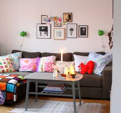 dark couch + bright pillows + neutral coffee table