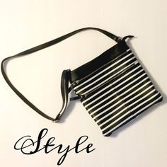 Black & White Stripped Crossbody Black and white Crossbody in perfect condition. No flaws! Two zipper pockets in the front and a pocket in the back. There is a zipper pocket on the inside as well. The strap is adjustable. It's approx 11 inches long and wide. Merona Bags Crossbody Bags