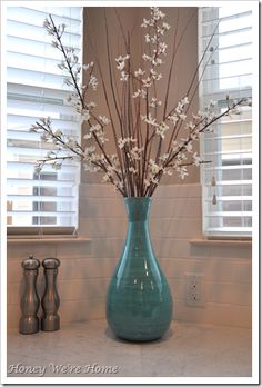 aqua vase - Google Search collect vases at garage sales, ross, marshalls, hobby lobby. don't worry about the color they are when you buy them....remember spray paint is your friend! don't forget to tie a pretty red ribbon around the necks of the vases!