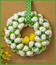 Cute Easter Egg Wreath made with confetti eggs and fuzzy chicks! DIY on CraftsnCoffee.com.