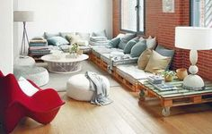 A coffee table and a full couch made from many different pallets