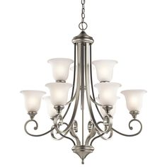 This 9 light chandelier from the Monroe™ lighting collection is a unique twist on traditional Americana. The distinctive metal base is touched with an Olde Bronze finish, which beautifully complements the Light Umber Etched Glass adornment. With this design, we have turned tradition on its head to create an updated look