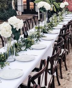Beautiful wedding rehearsal dinner table set up in this Mediterranean Tuscan style courtyard. Green garland, white flowers, stick candles, brown wood cross back chairs, wine glasses and bottles of wine complete the set up. Wedding Rehearsal, Rehearsal Dinners, Dinner Table Set Up, Event Venues, Wedding Venues, Spanish Style Weddings, Elegant Wedding Themes, Mediterranean Wedding, Green Garland