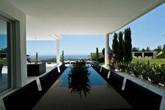 black dining table @  luxury villa  in Cascade de Camojan, Golden Mile, Marbella, Spain.
