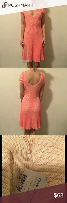 NWT FREE PEOPLE Neon Pink Ribbed Sweater Dress Gorgeous New With Tags Free People neon pink ribbed sweater dress with short sleeves and is above knee length! Size medium and is super cute and unique! Free People Dresses